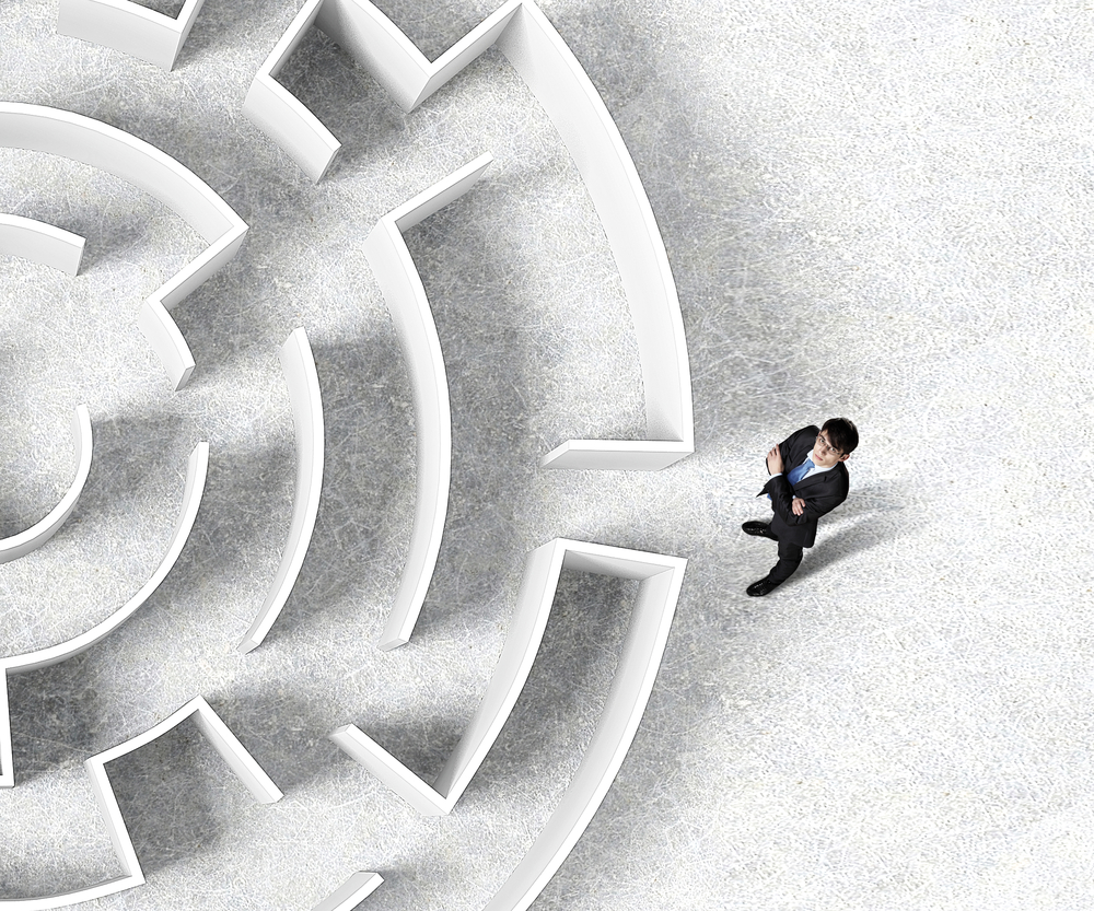 Top view of successful businessman standing near the entrance of labyrinth-1